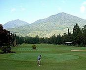 playing golf surrounded by mountains