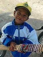 One of many young bracelet sellers